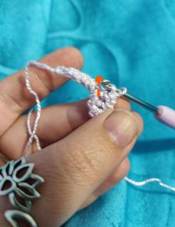Then pick up the two loops on the opposing cord